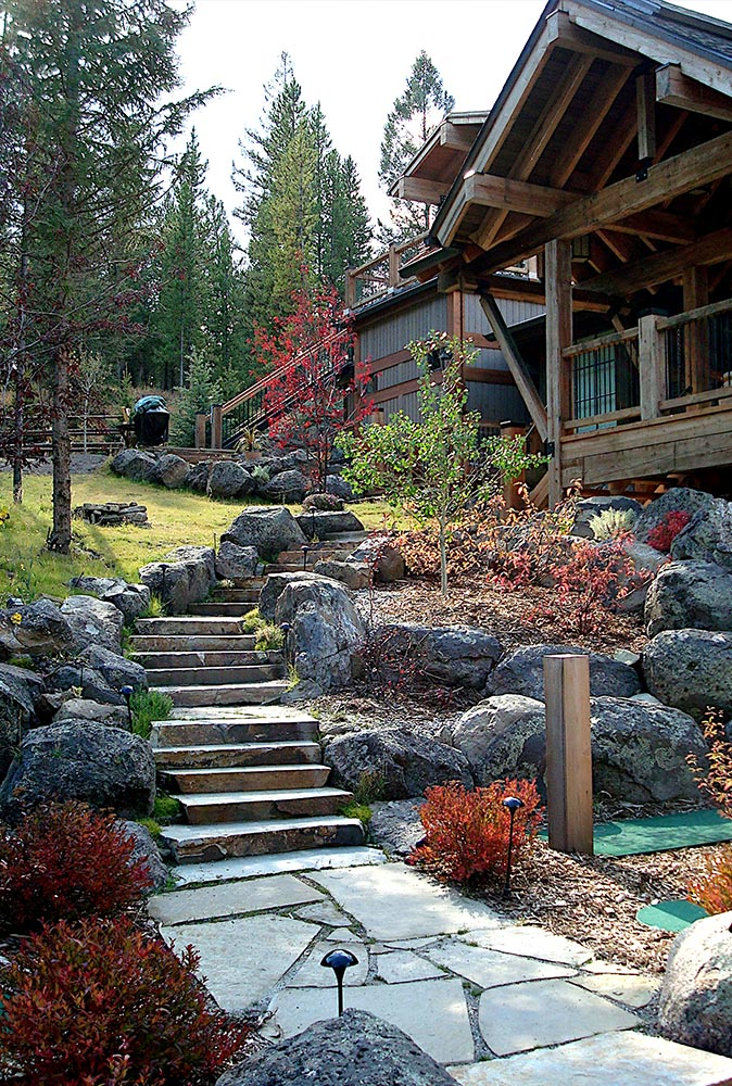 Front of a house with big stone slab stairs leading up to the front porch
